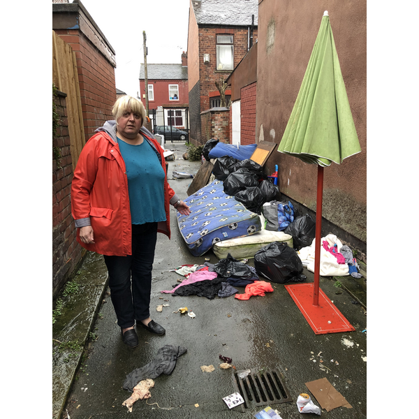Jacke Pearcey with rubbish she has reported. (By Charles Turner)
