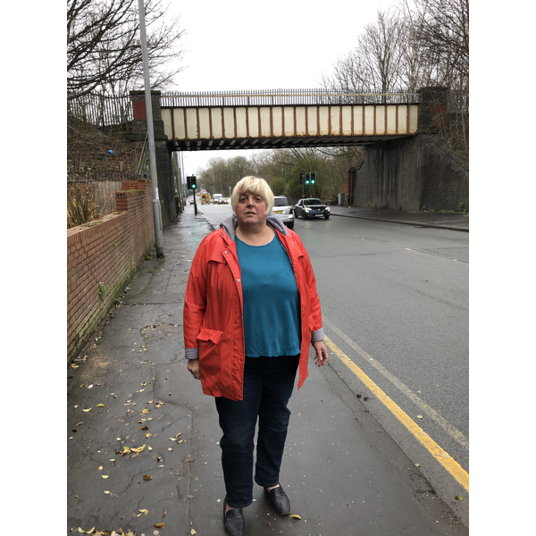 Jackie Pearcey at the Hyde Road Bridge to be demolished in the road widening. (By Charles Turner)