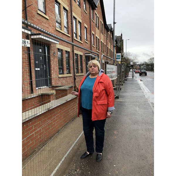Jackie at the new houses fronting Hyde Road. (By Charles Turner)